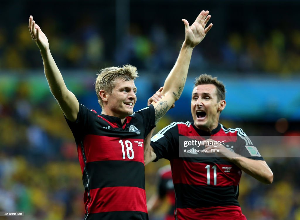 <a gi-track='captionPersonalityLinkClicked' href=/galleries/search?phrase=Toni+Kroos&family=editorial&specificpeople=638597 ng-click='$event.stopPropagation()'>Toni Kroos</a> (L) of Germany celebrates scoring his team's third goal withi his teammate <a gi-track='captionPersonalityLinkClicked' href=/galleries/search?phrase=Miroslav+Klose&family=editorial&specificpeople=206489 ng-click='$event.stopPropagation()'>Miroslav Klose</a> during the 2014 FIFA World Cup Brazil Semi Final match between Brazil and Germany at Estadio Mineirao on July 8, 2014 in Belo Horizonte, Brazil.