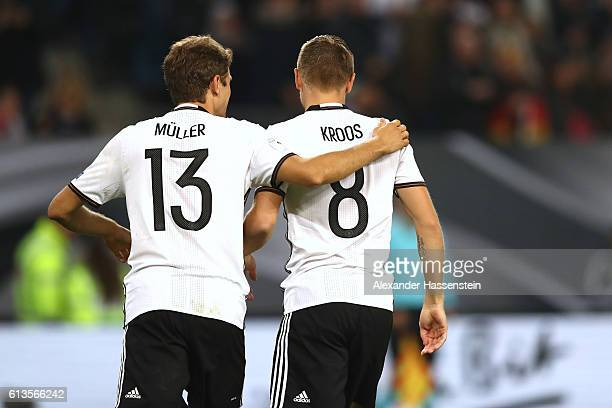 Toni Kroos of Germany celebrates scoring the 2nd goal with his team mate Thomas Mueller during the 2018 FIFA World Cup Qualifier match between...