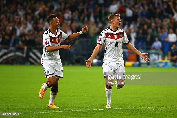 Toni Kroos of Germany celebrates scoring their first goal with Karim Bellarabi of Germany during the EURO 2016 Qualifier between Germany and Republic...
