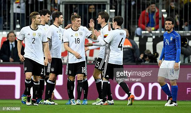 Toni Kroos of Germany celebrates with tema mates after scoring his teams first goal during the International Friendly match between Germany and Italy...