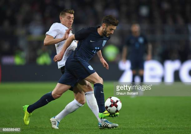 Toni Kroos of Germany closes down Adam Lallana of England during the international friendly match between Germany and England at Signal Iduna Park on...