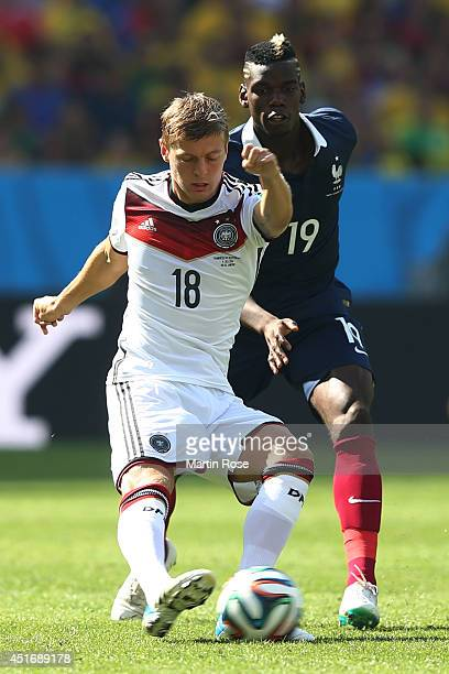 Toni Kroos of Germany controls the ball against Paul Pogba of France during the 2014 FIFA World Cup Brazil Quarter Final match between France and...