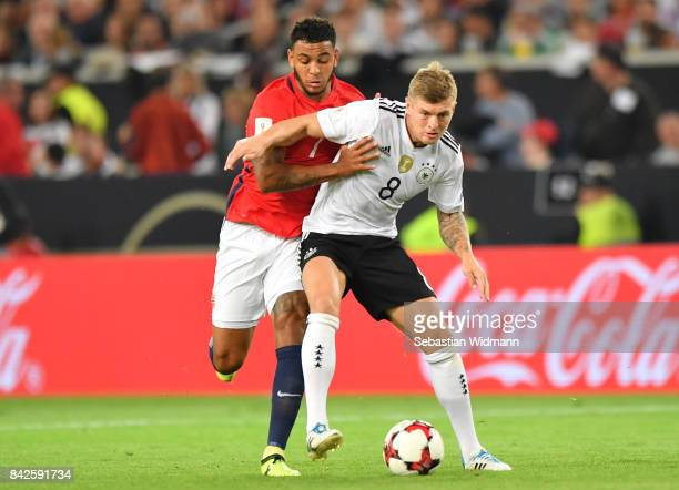 Toni Kroos of Germany fights for the ball with Joshua King of Norway during the FIFA 2018 World Cup Qualifier between Germany and Norway at...