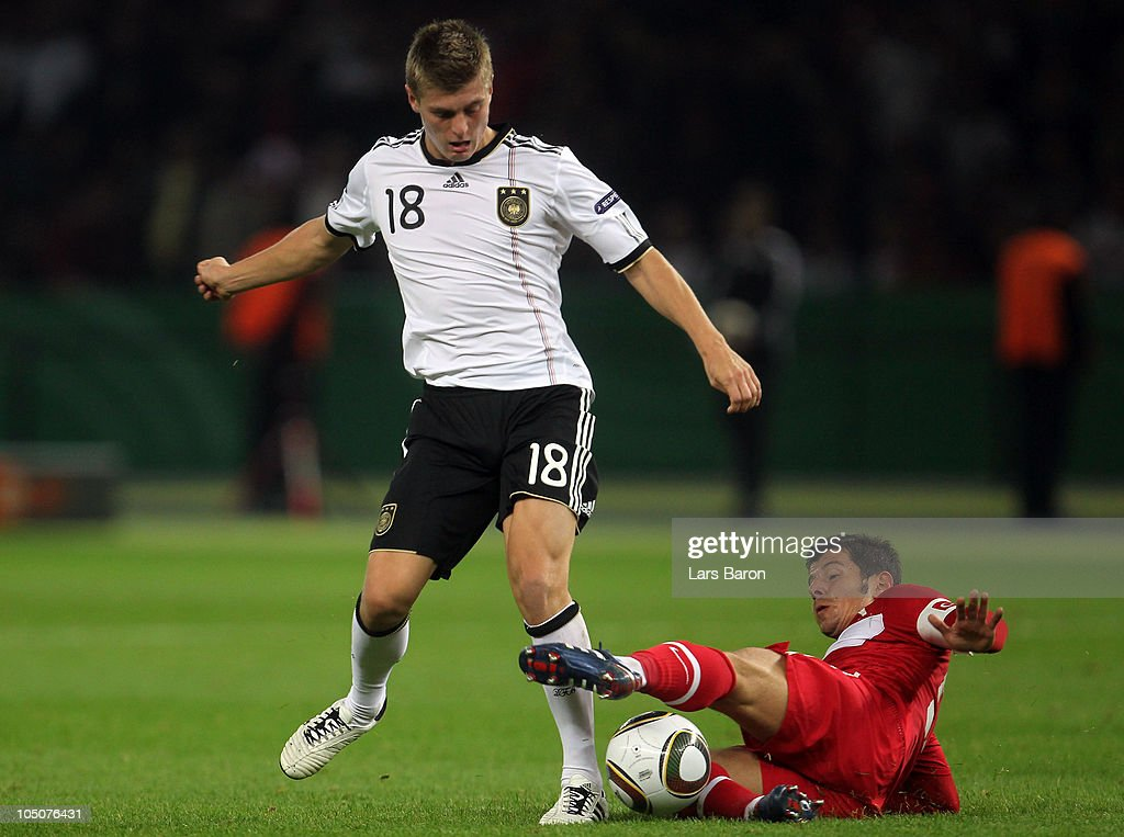 <a gi-track='captionPersonalityLinkClicked' href=/galleries/search?phrase=Toni+Kroos&family=editorial&specificpeople=638597 ng-click='$event.stopPropagation()'>Toni Kroos</a> of Germany is challenged by Emre Beloezoglu of Turkey during the EURO 2012 Group A qualifier match between Germany and Turkey at Olympic Stadium on October 8, 2010 in Berlin, Germany.