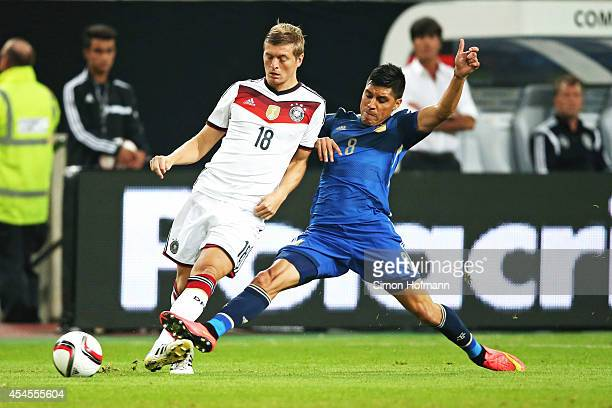 Toni Kroos of Germany is challenged by Enzo Perez of Argentina during the international friendly match between Germany and Argentina at EspritArena...