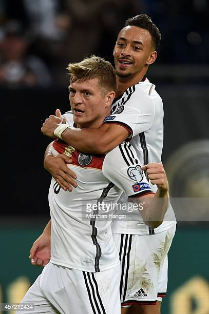 Toni Kroos of Germany is congratulated by teammate Karim Bellarabi of Germany after scoring the opening goal during the EURO 2016 Qualifier between...