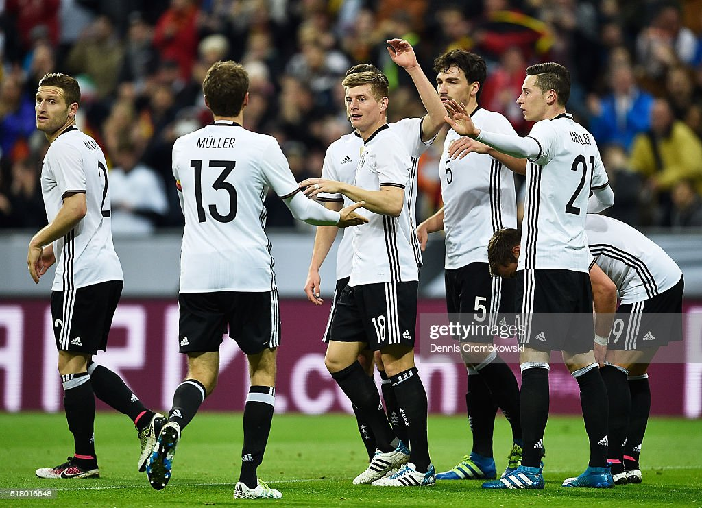 Toni Kroos of Germany is congratulated by Thomas Mueller after scoring a goal during the International Friendly match between Germany and Italy at Allianz Arena on March 29, 2016 in Munich, Germany.