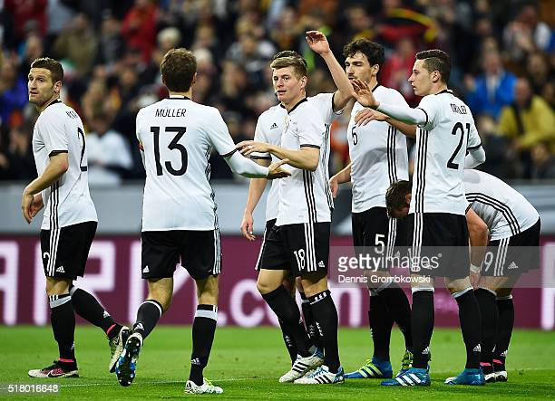 Toni Kroos of Germany is congratulated by Thomas Mueller after scoring a goal during the International Friendly match between Germany and Italy at...