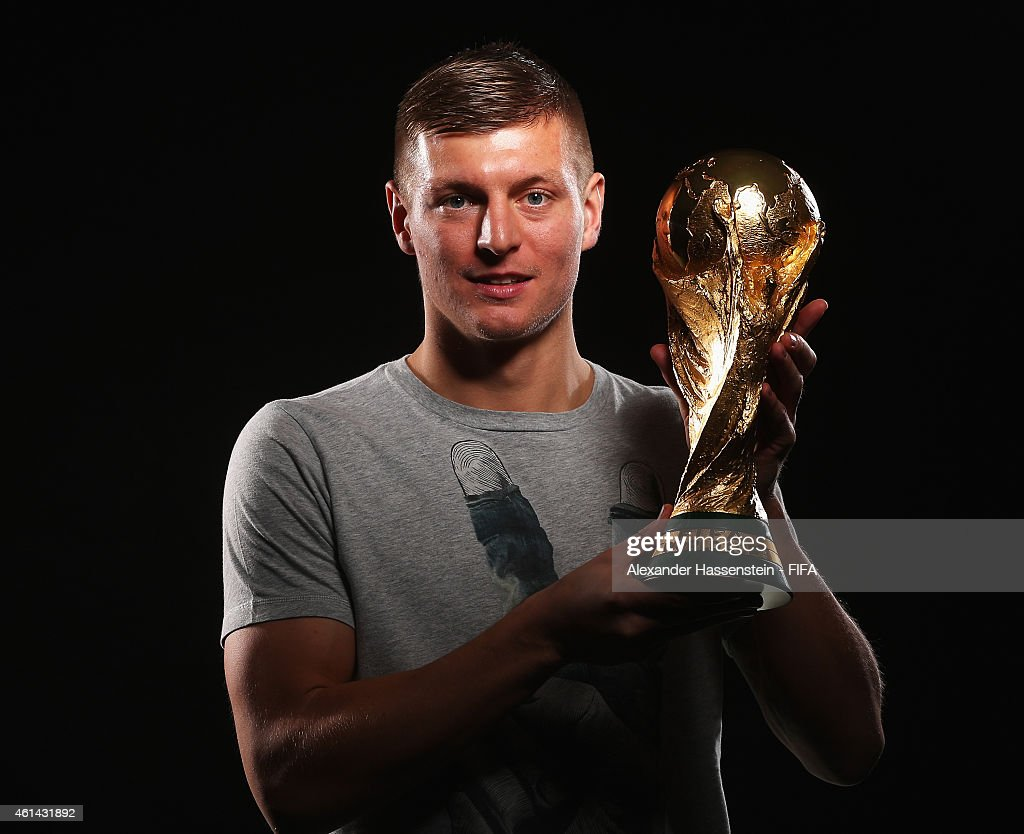 <a gi-track='captionPersonalityLinkClicked' href=/galleries/search?phrase=Toni+Kroos&family=editorial&specificpeople=638597 ng-click='$event.stopPropagation()'>Toni Kroos</a> of Germany poses with the FIFA World Cup Trophy prior to the FIFA Ballon d'Or Gala 2014 at the Park Hyatt hotel on January 12, 2015 in Zurich, Switzerland.