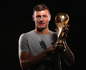 Toni Kroos of Germany poses with the FIFA World Cup Trophy prior to the FIFA Ballon d'Or Gala 2014 at the Park Hyatt hotel on January 12 2015 in...