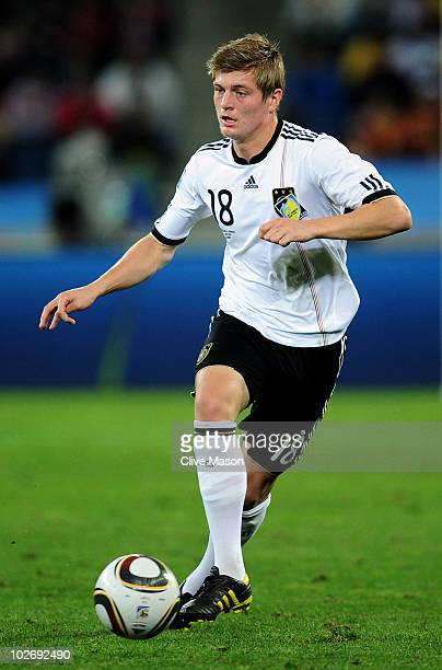 Toni Kroos of Germany runs with the ball during the 2010 FIFA World Cup South Africa Semi Final match between Germany and Spain at Durban Stadium on...