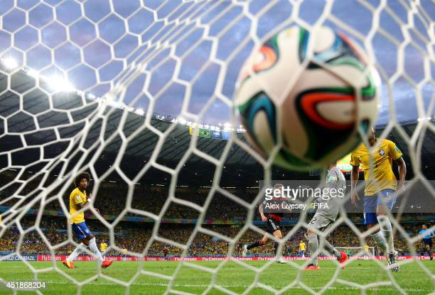 Toni Kroos of Germany scores his team's foruth goal during the 2014 FIFA World Cup Brazil Semi Final match between Brazil and Germany at Estadio...
