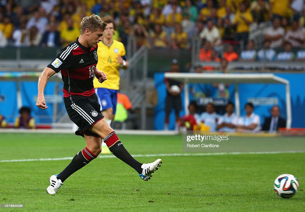 <a gi-track='captionPersonalityLinkClicked' href=/galleries/search?phrase=Toni+Kroos&family=editorial&specificpeople=638597 ng-click='$event.stopPropagation()'>Toni Kroos</a> of Germany scores his team's fourth goal during the 2014 FIFA World Cup Brazil Semi Final match between Brazil and Germany at Estadio Mineirao on July 8, 2014 in Belo Horizonte, Brazil.