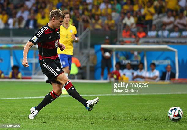 Toni Kroos of Germany scores his team's fourth goal during the 2014 FIFA World Cup Brazil Semi Final match between Brazil and Germany at Estadio...