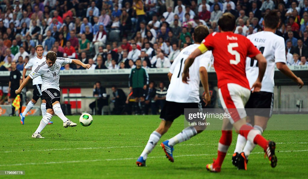 <a gi-track='captionPersonalityLinkClicked' href=/galleries/search?phrase=Toni+Kroos&family=editorial&specificpeople=638597 ng-click='$event.stopPropagation()'>Toni Kroos</a> of Germany scores his teams second goal during the FIFA 2014 World Cup Qualifying Group C match between Germany and Austria Allianz Arena on September 6, 2013 in Munich, Germany.