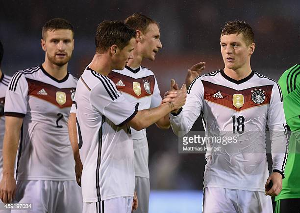 Toni Kroos of Germany shakes hand with Erik Durm of Germany after the International Friendly match between Spain and Germany at Estadio Balaidos on...