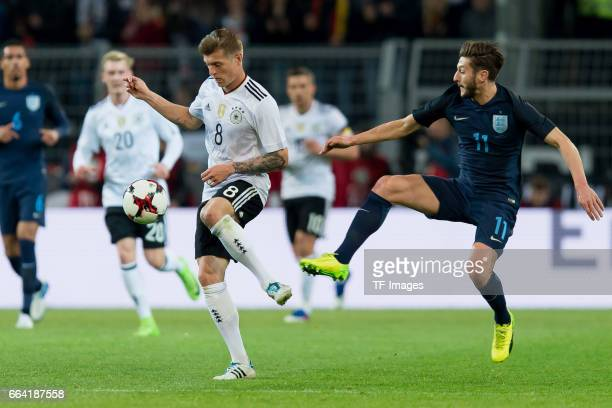 Toni Kroos of Germany und Adam Lallana battle for the ball during the international friendly match between Germany and England at Signal Iduna Park...