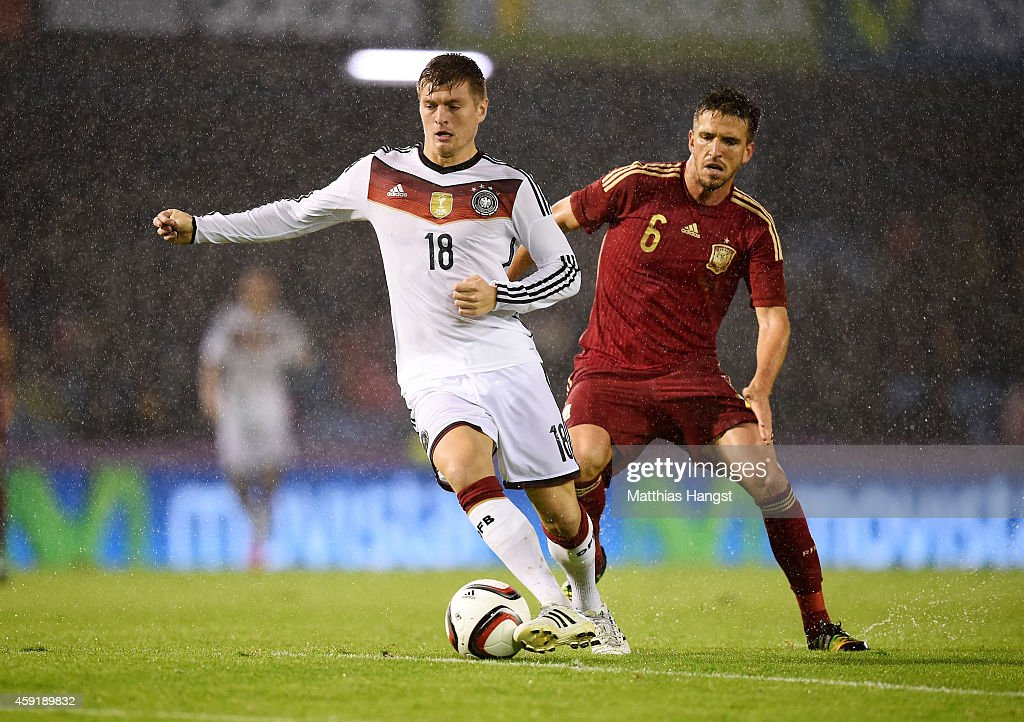 <a gi-track='captionPersonalityLinkClicked' href=/galleries/search?phrase=Toni+Kroos&family=editorial&specificpeople=638597 ng-click='$event.stopPropagation()'>Toni Kroos</a> (L) of Germany vies with Ignacio Camacho of Spain during the International Friendly match between Spain and Germany at Estadio Balaidos on November 18, 2014 in Vigo, Spain.