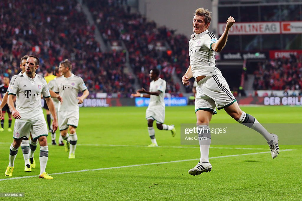 <a gi-track='captionPersonalityLinkClicked' href=/galleries/search?phrase=Toni+Kroos&family=editorial&specificpeople=638597 ng-click='$event.stopPropagation()'>Toni Kroos</a> of Muenchen celebrates his team's first goal during the Bundesliga match between Bayer Leverkusen and FC Bayern Muenchen at BayArena on October 5, 2013 in Leverkusen, Germany.