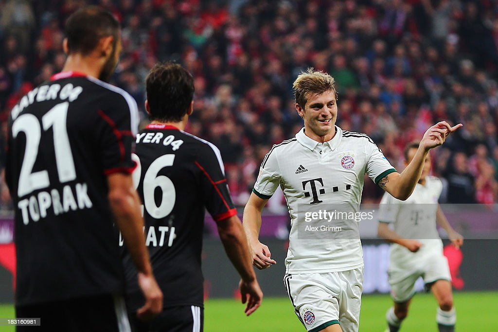 Toni Kroos of Muenchen celebrates his team's first goal during the Bundesliga match between Bayer Leverkusen and FC Bayern Muenchen at BayArena on October 5, 2013 in Leverkusen, Germany.