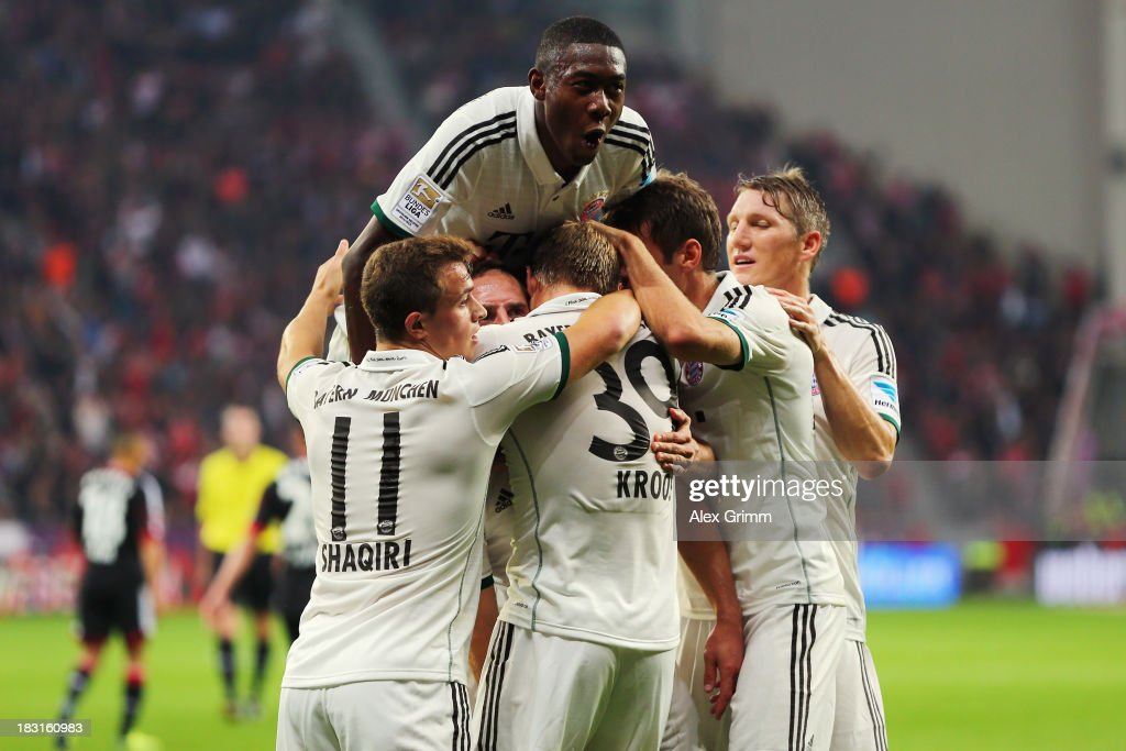 Toni Kroos of Muenchen (C) celebrates his team's first goal with team mates during the Bundesliga match between Bayer Leverkusen and FC Bayern Muenchen at BayArena on October 5, 2013 in Leverkusen, Germany.