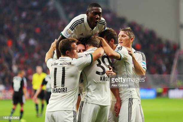Toni Kroos of Muenchen celebrates his team's first goal with team mates during the Bundesliga match between Bayer Leverkusen and FC Bayern Muenchen...