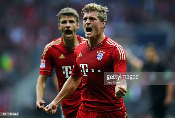 Toni Kroos of Muenchen celebrates next to team mate Thomas Mueller after scoring his teams second goal during the Bundesliga match between FC Bayern...