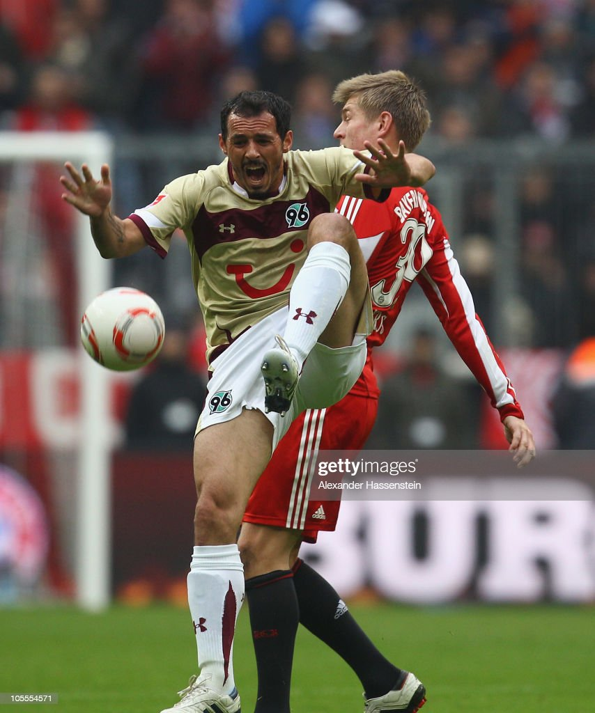 Toni Kroos (R) of Muenchen fouls <a gi-track='captionPersonalityLinkClicked' href=/galleries/search?phrase=Sergio+Pinto&family=editorial&specificpeople=683636 ng-click='$event.stopPropagation()'>Sergio Pinto</a> (C) of Hannover during the Bundesliga match between FC Bayern Muenchen and Hannover 96 at Allianz Arena on October 16, 2010 in Munich, Germany.