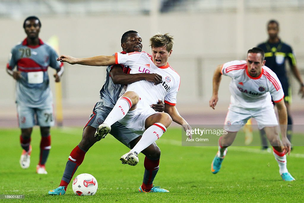 <a gi-track='captionPersonalityLinkClicked' href=/galleries/search?phrase=Toni+Kroos&family=editorial&specificpeople=638597 ng-click='$event.stopPropagation()'>Toni Kroos</a> of Muenchen is challenged by Tresor Kangambu of Lekhwiya during the international friendly match between Lekhwiya Sports Club and FC Bayern Muenchen at Khalifa International Stadium on January 5, 2013 in Doha, Qatar.