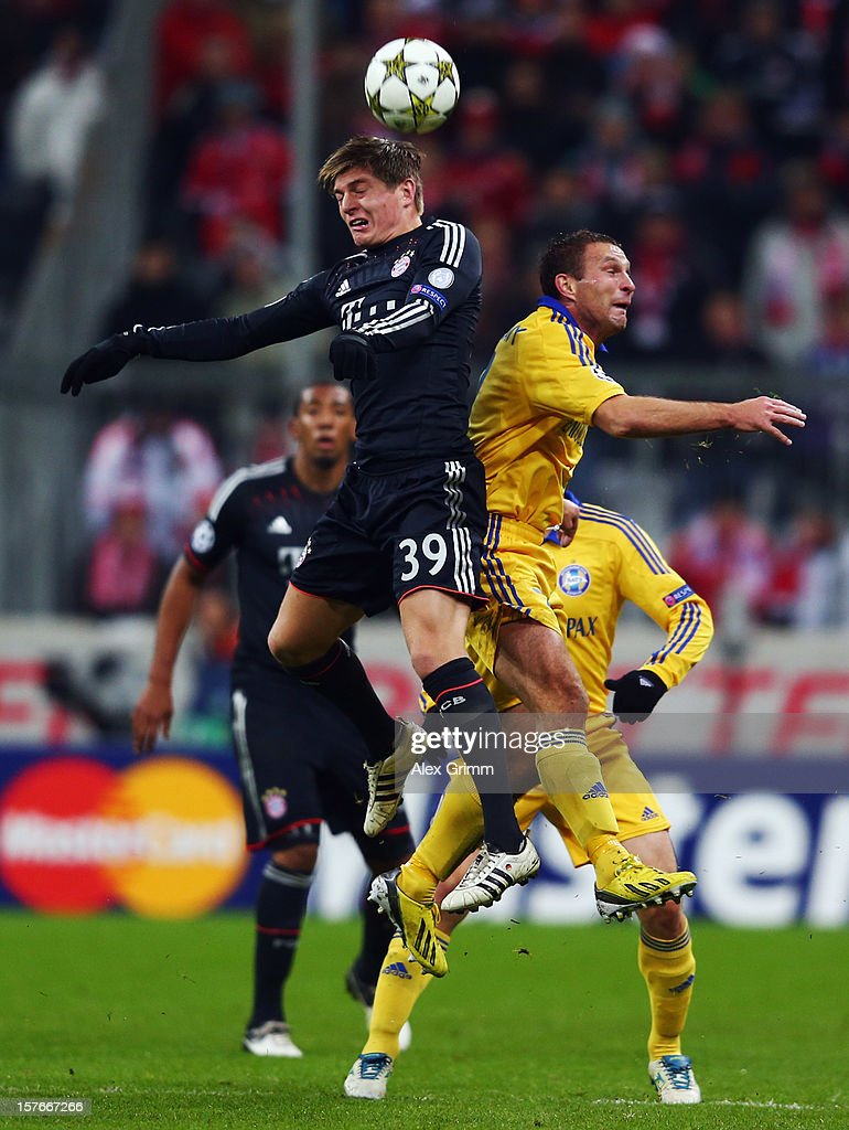 Toni Kroos (L) of Muenchen jumps for a header with Artem Kontsevo of Borisov during the UEFA Champions League Group F match between FC Bayern Muenchen and FC BATE Borisov at Allianz Arena on December 5, 2012 in Munich, Germany.