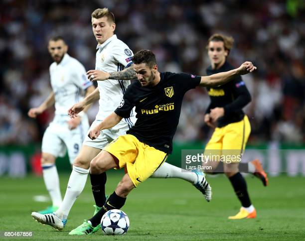 Toni Kroos of Real challenges Koke of Atletico during the UEFA Champions League Semi Final first leg match between Real Madrid CF and Club Atletico...