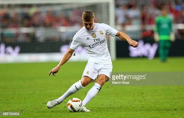 Toni Kroos of Real Madird runs with the ball during the Audi Cup 2015 final match between FC Bayern Muenchen and Real Madrid at Allianz Arena on...