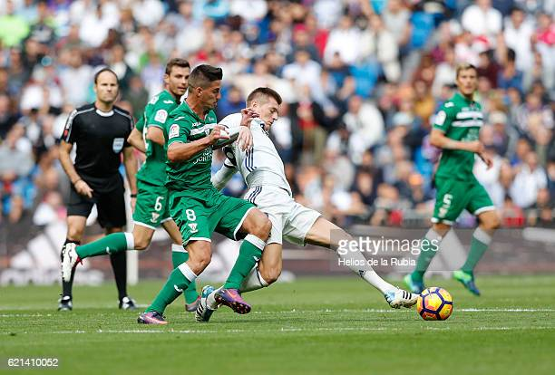 Toni Kroos of Real Madrid and Gabriel Pires of Leganes compete for the ball during the La Liga match between Real Madrid CF and Leganes at Estadio...