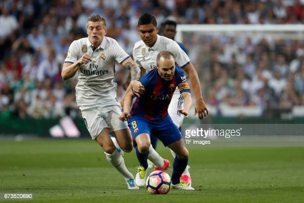 Toni Kroos of Real Madrid and Iniesta of FC Barcelona battle for the ball during the La Liga match between Real Madrid CF and FC Barcelona at the...
