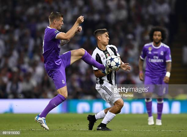 Toni Kroos of Real Madrid and Paulo Dybala of Juventus battle for possession during the UEFA Champions League Final between Juventus and Real Madrid...