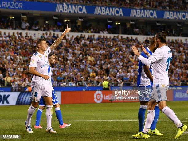 Toni Kroos of Real Madrid celebrates after scores the third goal whit Gareth Bale during the La Liga match between Deportivo La Coruna and Real...