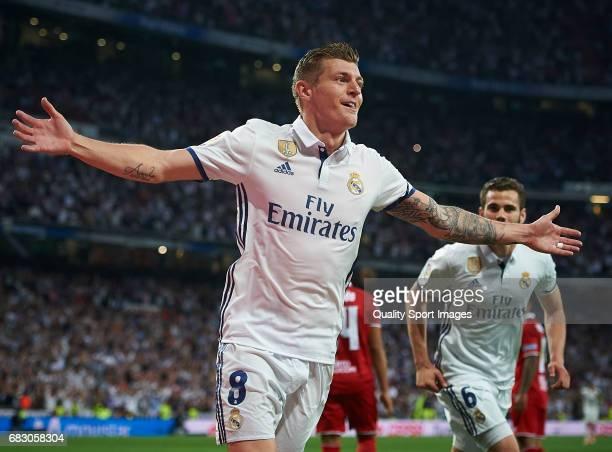 Toni Kroos of Real Madrid celebrates after scoring the fourth goal during the La Liga match between Real Madrid CF and Sevilla CF at Estadio Santiago...