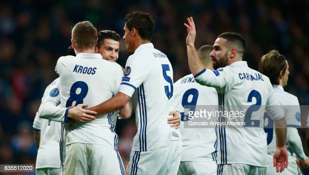 Toni Kroos of Real Madrid celebrates with Cristiano Ronaldo and Raphael Varane as he scores their second goal during the UEFA Champions League Round...