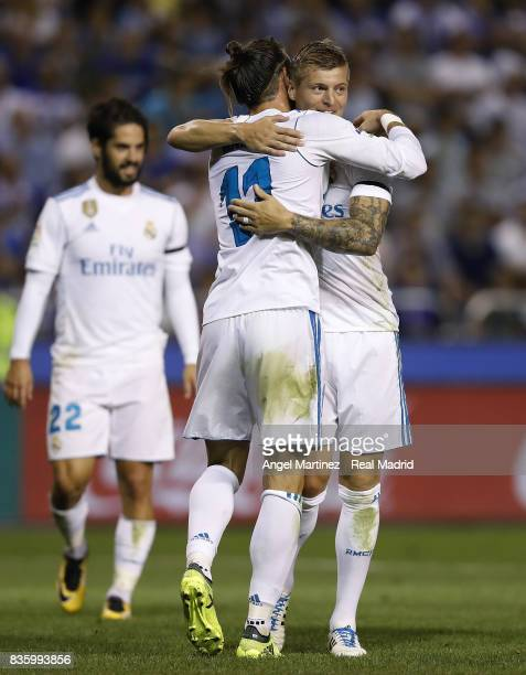 Toni Kroos of Real Madrid celebrates with Gareth Bale after scoring their team's third goal during the La Liga match between Deportivo La Coruna and...