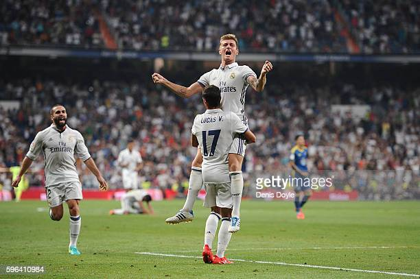 Toni Kroos of Real Madrid celebrates with Lucas Vazquez after scoring Real's 2nd goal during the La Liga match between Real Madrid CF and RC Celta de...