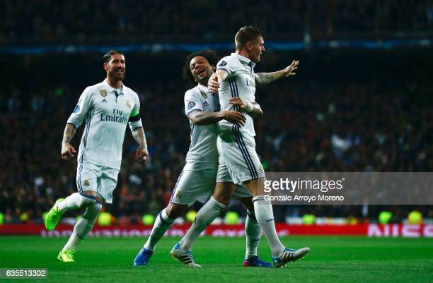 Toni Kroos of Real Madrid celebrates with Sergio Ramos and Marcelo as he scores their second goal during the UEFA Champions League Round of 16 first...