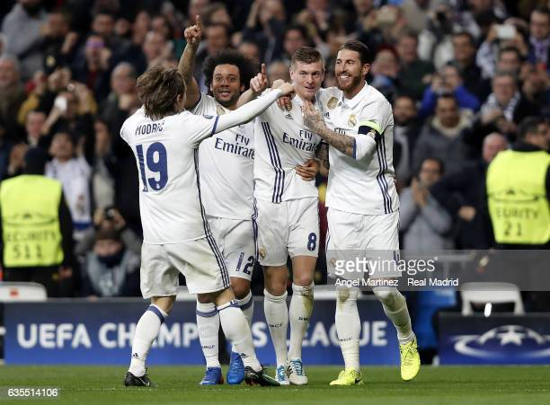 Toni Kroos of Real Madrid celebrates with team mates after scoring their team's second goal during the UEFA Champions League Round of 16 first leg...