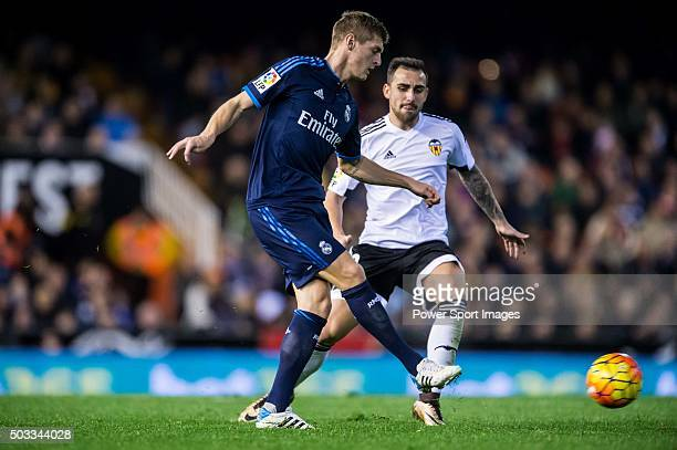 Toni Kroos of Real Madrid CF being followed by Paco Alcacer of Valencia CF during the Valencia CF vs Real Madrid CF as part of the Liga BBVA 20152016...