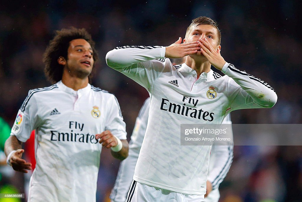 <a gi-track='captionPersonalityLinkClicked' href=/galleries/search?phrase=Toni+Kroos&family=editorial&specificpeople=638597 ng-click='$event.stopPropagation()'>Toni Kroos</a> of Real Madrid CF celebrates scoring their third goal during the La Liga match between Real Madrid CF and Rayo Vallecano de Madrid at Estadio Santiago Bernabeu on November 8, 2014 in Madrid, Spain.