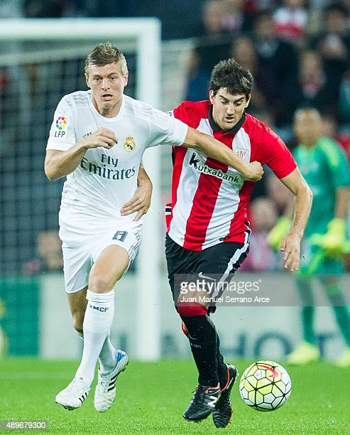 BILBAO SPAIN SEPTEMBER 23 Toni Kroos of Real Madrid CF duels for the ball with Mikel San Jose of Athletic Club Bilbao during the La Liga match...