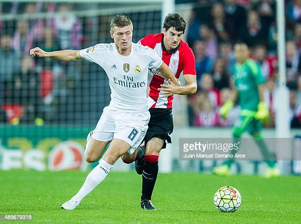 Toni Kroos of Real Madrid CF duels for the ball with Mikel San Jose of Athletic Club Bilbao during the La Liga match between Athletic Club Bilbao and...