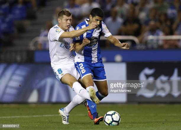 Toni Kroos of Real Madrid competes for the ball with Juanfran Moreno of Deportivo La Coruna during the La Liga match between Deportivo La Coruna and...
