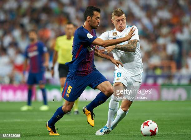 Toni Kroos of Real Madrid competes for the ball with Sergio Busquets of Barcelona during the Supercopa de Espana Supercopa Final 2nd Leg match...