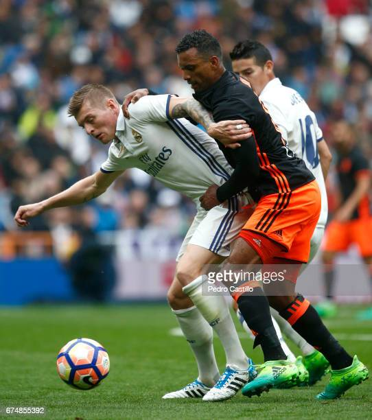 Toni Kroos of Real Madrid duels for the ball with Nani of Valencia CF during the La Liga match between Real Madrid and Valencia CF at Estadio...