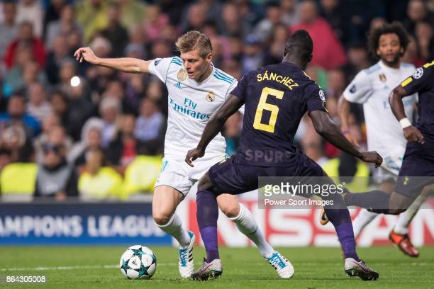 Toni Kroos of Real Madrid fights for the ball with Davinson Sanchez of Tottenham Hotspur FC during the UEFA Champions League 201718 match between...